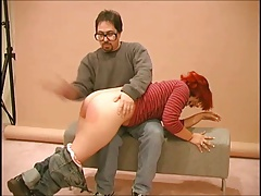 redhead spanked with an..