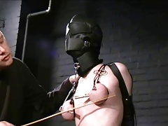 hooded slave racking with an..