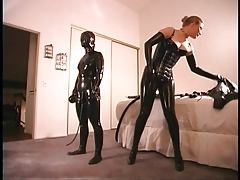 Rubber clad submissive feels..