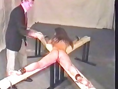 spanking His slave with belt