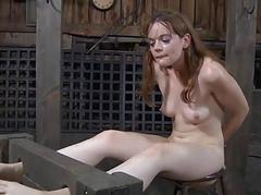 Caged hotty removes her..