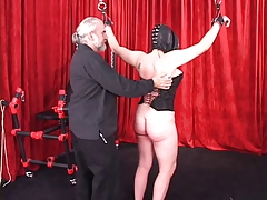 Spread-eagled shackled woman..