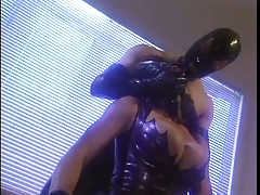 Latex clad couple in action