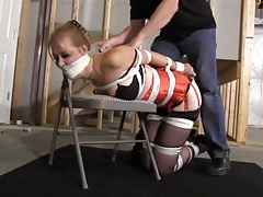 Krystina  hogtied in the air..