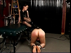 Mistress steps on his..