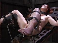 Caged cutie removes her..