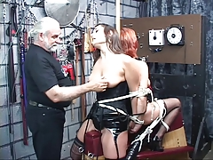 Two leather-corseted bdsm..