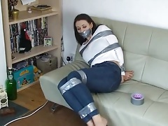 Taped up and helpless on couch