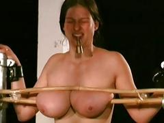 Tortured big tittied girl