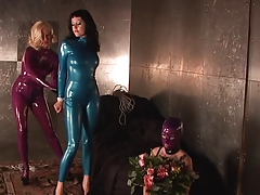 Slut far blue latex suit..