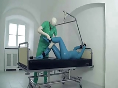 Carrying-on Doctor in Latex..