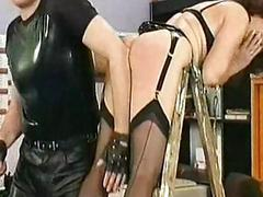 Milf slave in leather bowing..