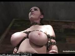 Busty chained redhead pussy..