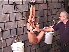 Young Nicole hangs bound to..